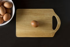 Eggs with napkin on black background. Eggs and cutting board with on black background Royalty Free Stock Photos