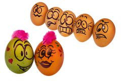 Eggs in natural colors look with horror, astonishment and fear a. Easter eggs, hand-made painted in various patterns and colors with cartoon faces. Eggs in Royalty Free Stock Photo