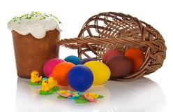 Eggs near basket and Easter cake with sweet Stock Photos