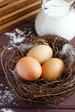 Eggs in the nest. Brown eggs in the nest. Wooden background Royalty Free Stock Photography
