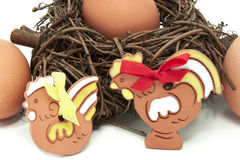Eggs in a nest with ceramic hen and cock. Eggs in a nest with decorated ceramic hen and cock Stock Image