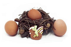 Eggs in a nest and ceramic hen. Eggs in wicker nest and  decorated ceramic hen Stock Photography