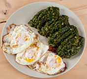 Eggs and nettle porridge Stock Photography