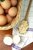 Eggs and oat flakes Royalty Free Stock Photography