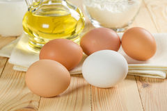 Eggs and oil Stock Photography