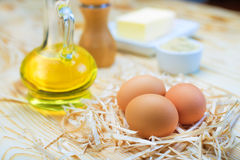 Eggs, oil and food ingredients Royalty Free Stock Photos