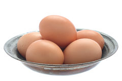 Eggs in old metal bowl Stock Photos