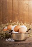 Eggs on old wooden Royalty Free Stock Photos