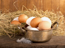 Eggs on old wooden Stock Images