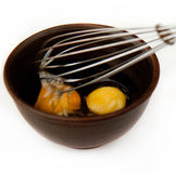 Eggs for omelet. Tow eggs for omelet in ceramic bowl on a white background Stock Photos