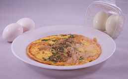 Eggs and Omelette. Raw and boiled eggs, and an omelette Stock Photo