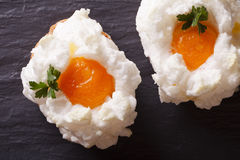 Eggs Orsini: baked whipped whites and yolks horizontal top view Royalty Free Stock Photo