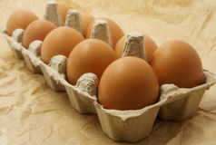 Eggs in the package on a brown paper. Selective focus Stock Photo