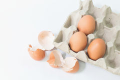 Eggs in the package with egg shell. Eggs in the package with egg shell on white background Royalty Free Stock Photo