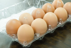 Eggs on package. Organic eggs in package on wooden table Royalty Free Stock Photo