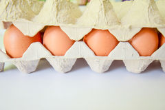 Eggs with package. Eggs put on the safety packaging to prevent broken them on white table Stock Photography