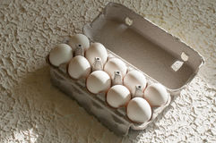 Eggs in the package white on table. Eggs in the package on white table background royalty free stock photos
