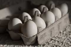 Eggs in the package white on table. Eggs in the package on white table background Royalty Free Stock Photo