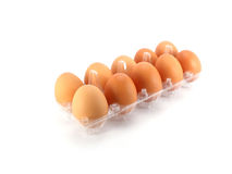 Eggs packed isolated white background Stock Photos