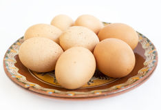 Eggs in painted ceramic plate Royalty Free Stock Photos