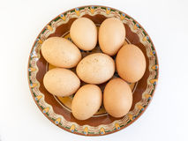 Eggs in painted ceramic plate Royalty Free Stock Image