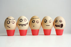 Eggs with painted face. Concept. Of the first September lineup. Meeting calls roll call. Funny face photo for your design stock photo