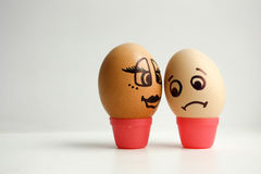Eggs with painted face. The concept. Of love between white and black is unrequited. Photo for your design royalty free stock photos