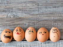 Eggs with painted faces. Photo for your design. Concept of joint Royalty Free Stock Photography