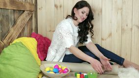 Eggs painting for easter, young woman prepares for holiday