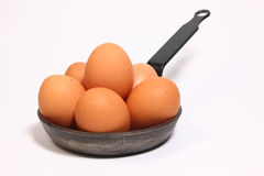 Eggs in a pan Stock Photos