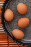 Eggs on a pan Stock Photo