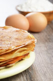 Eggs, pancakes, flour Royalty Free Stock Images