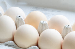 Eggs in paper egg carton Royalty Free Stock Image