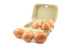 Eggs and paper egg carton on white background Stock Photos