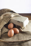 Eggs and paper pack Natural style Stock Images