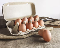 Eggs in paper pack on sack cloth Royalty Free Stock Images