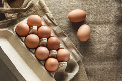 Eggs in paper pack on sack cloth Stock Images