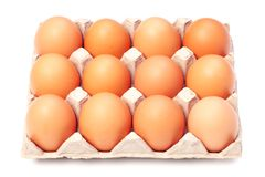 Eggs. In a paper package on white background Stock Images