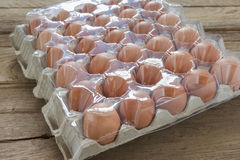 Eggs in paper tray with cover Royalty Free Stock Images