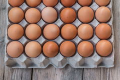 Eggs in paper tray Stock Photo