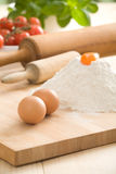 Eggs on pastry board Royalty Free Stock Photography