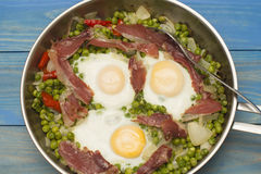 Eggs with peas and ham. Three eggs with peas Stock Photos