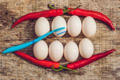 Eggs and peppers in the form of a mouth with teeth and a toothbrush. cleaning the teeth of the concept stock photo