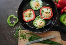 Eggs in peppers Stock Photo