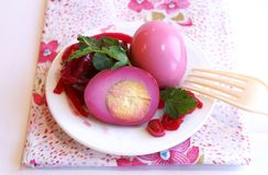 Eggs pickled with red beet. A plate with eggs pickled in red beet marinade Stock Photo