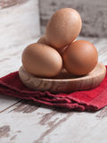 Eggs piled on a wooden plate Stock Image