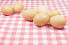 Eggs on pink color plaid Royalty Free Stock Photography