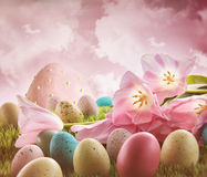 Eggs with pink tulips in the grass Stock Image