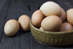 Eggs placed on the old dirty cracked wooden floor Royalty Free Stock Images