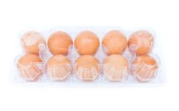Eggs in a plastic carton. Isolated on a white background Stock Photo